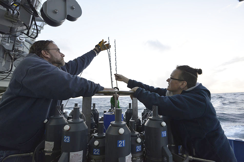Technicians Chris Griner and Amy Simoneau prepare the ship's CTD for winch tests in deep water.