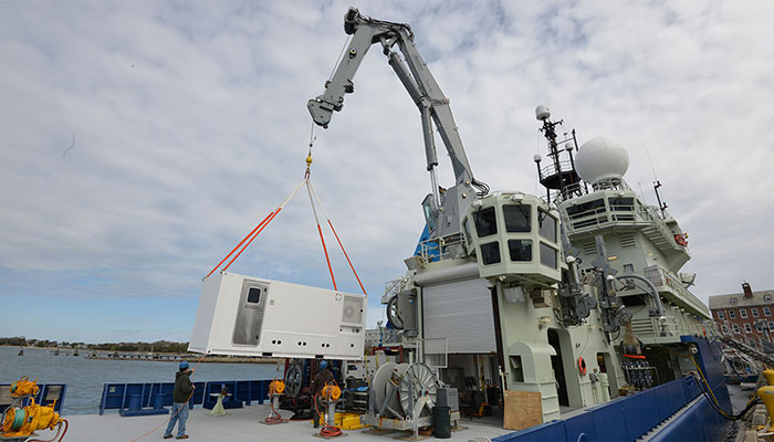 The ROV van, where we will be spending many hours on the cruise, is loaded onto Neil Armstrong.